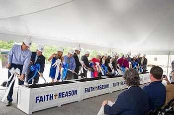 Members of the USF Community break ground on the new Chapel, part of the Faith + Reason campaign